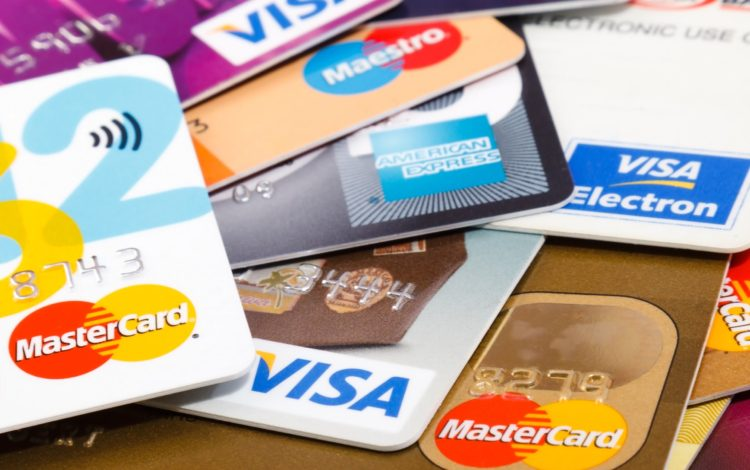 how to use credit cards to build credit score